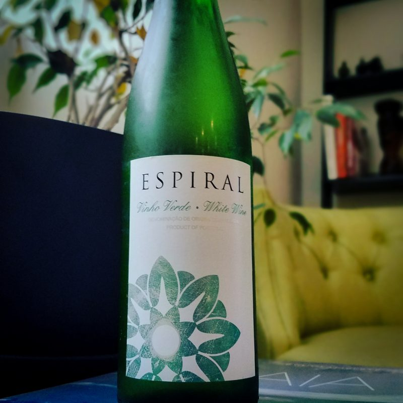 "Vinho Verde. It means ""green wine"" or rather ""young wine"" by intent. This wine is meant to drink in the first year. And while the name indicates that it is a young wine, the name actually stands for a region in Northern Portugal, where these wines are made."