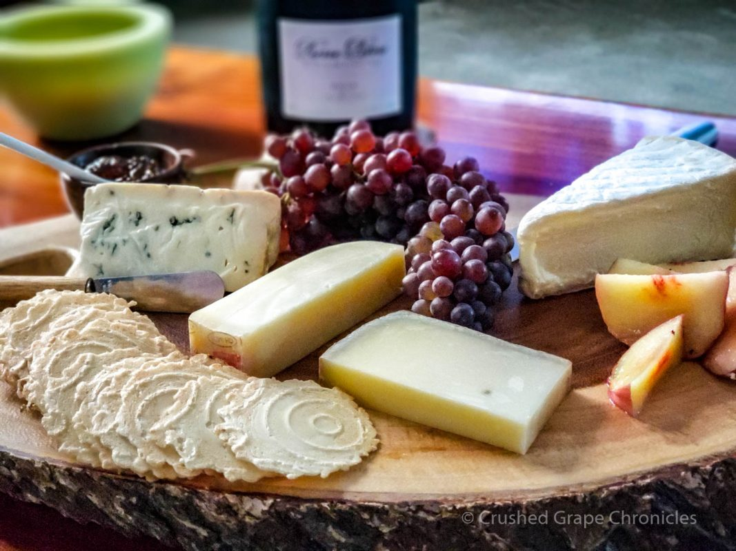A selection of cheeses with Grower Champagne