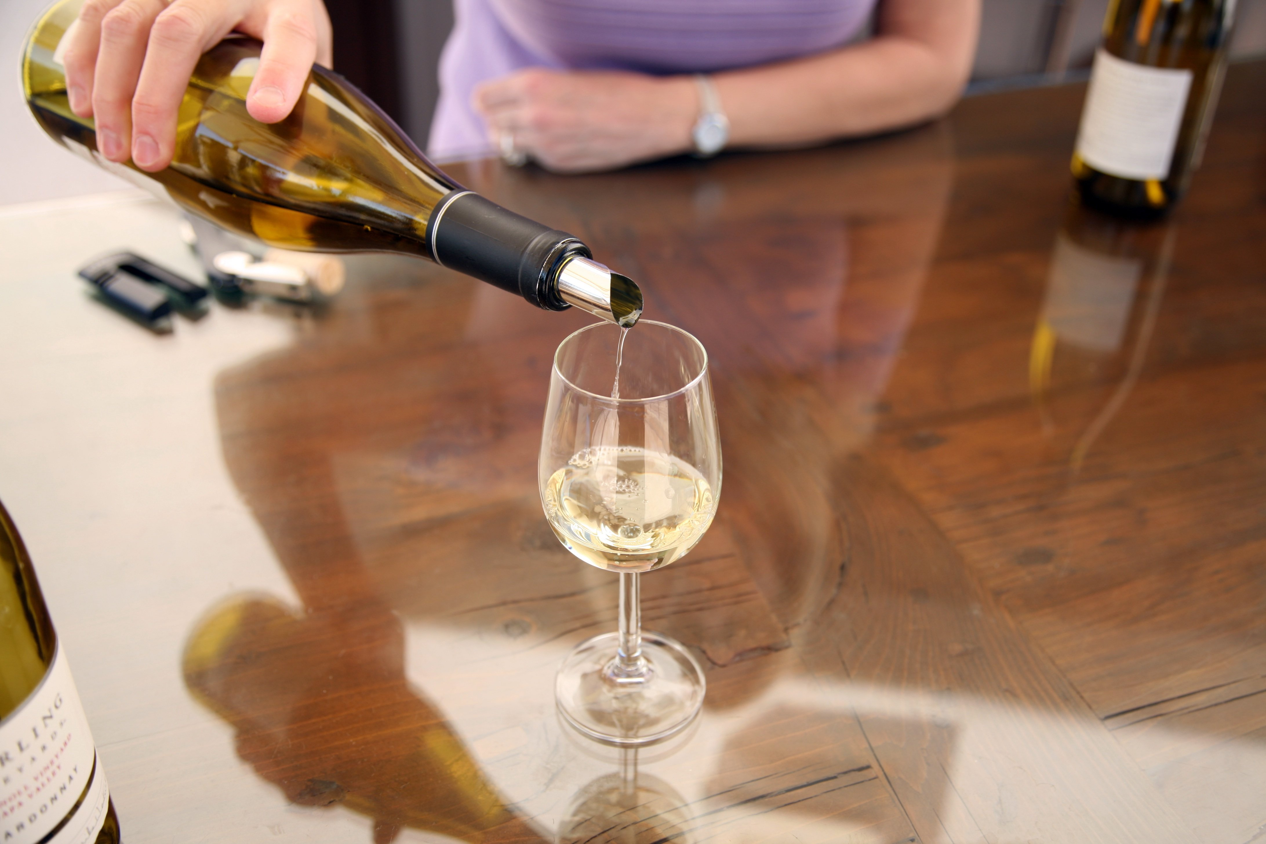 wine being poured from a bottle to a wine glass1