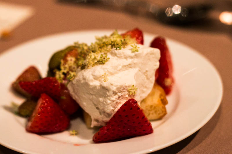 Savarin with ripe and unripe strawberries and a brown butter crème fraiche.