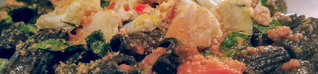 squid ink rigatoni served with spicy king crab and a calamari ragu with tomatoes at Masso Osteria