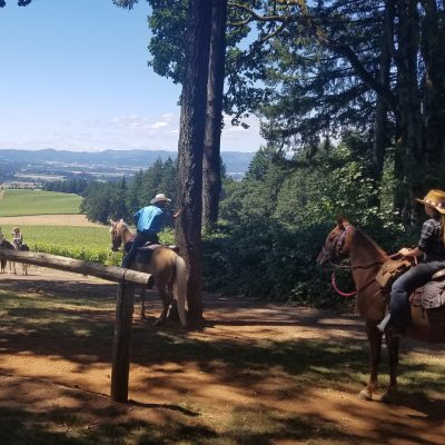 A group on horseback stopping through at the Uncommon Wine Festival at Vista Hills