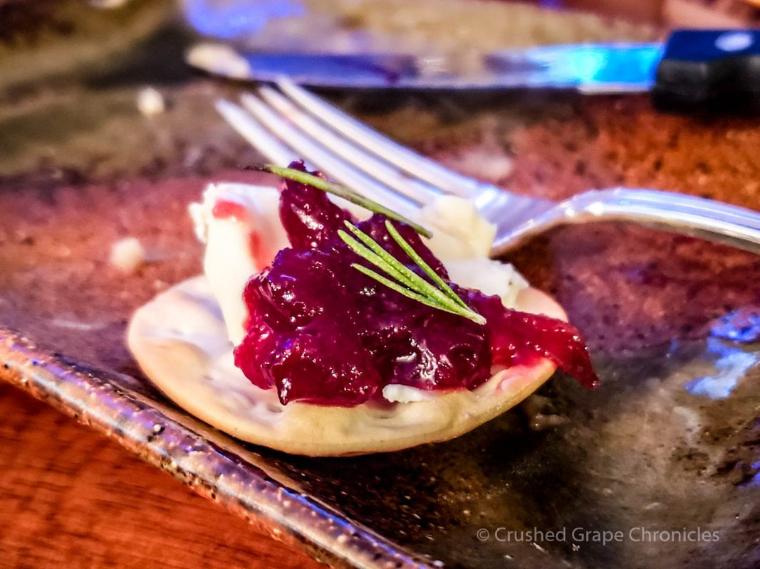 Honeyed goat cheese with cherry preserves and rosemary