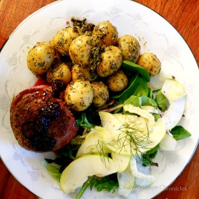 Bacon wrapped tenderloin fillet encrusted in black pepper and cumin, with a blackberry and red currant sauce, fennel and apple salad and potatoes with Herbs de Provençe