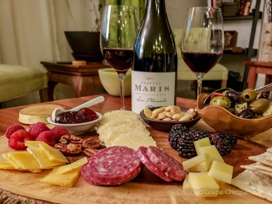 Cheese and charcuterie with the Chateau Maris 2011 Les Planels. Marcona Almonds, raspberries, italian sausage, pecans, blackberries, compt, aged gouda, crackers and a calabrese antipasto.