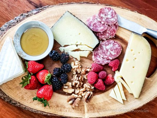 Cheese and Chacuterie platter Gouda, triple creme, manchego, berries, nuts, honey, sopresso