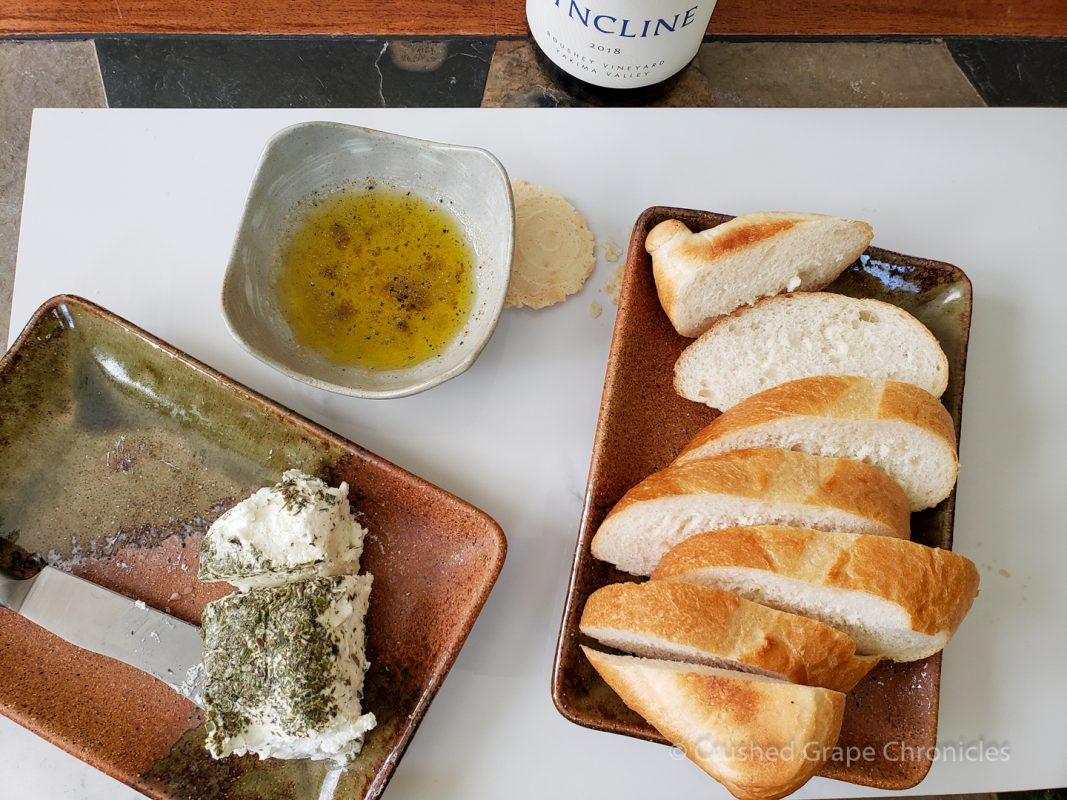 Herbed goat cheese with the Syncline 2018 Picpoul from Boushey Vineyard