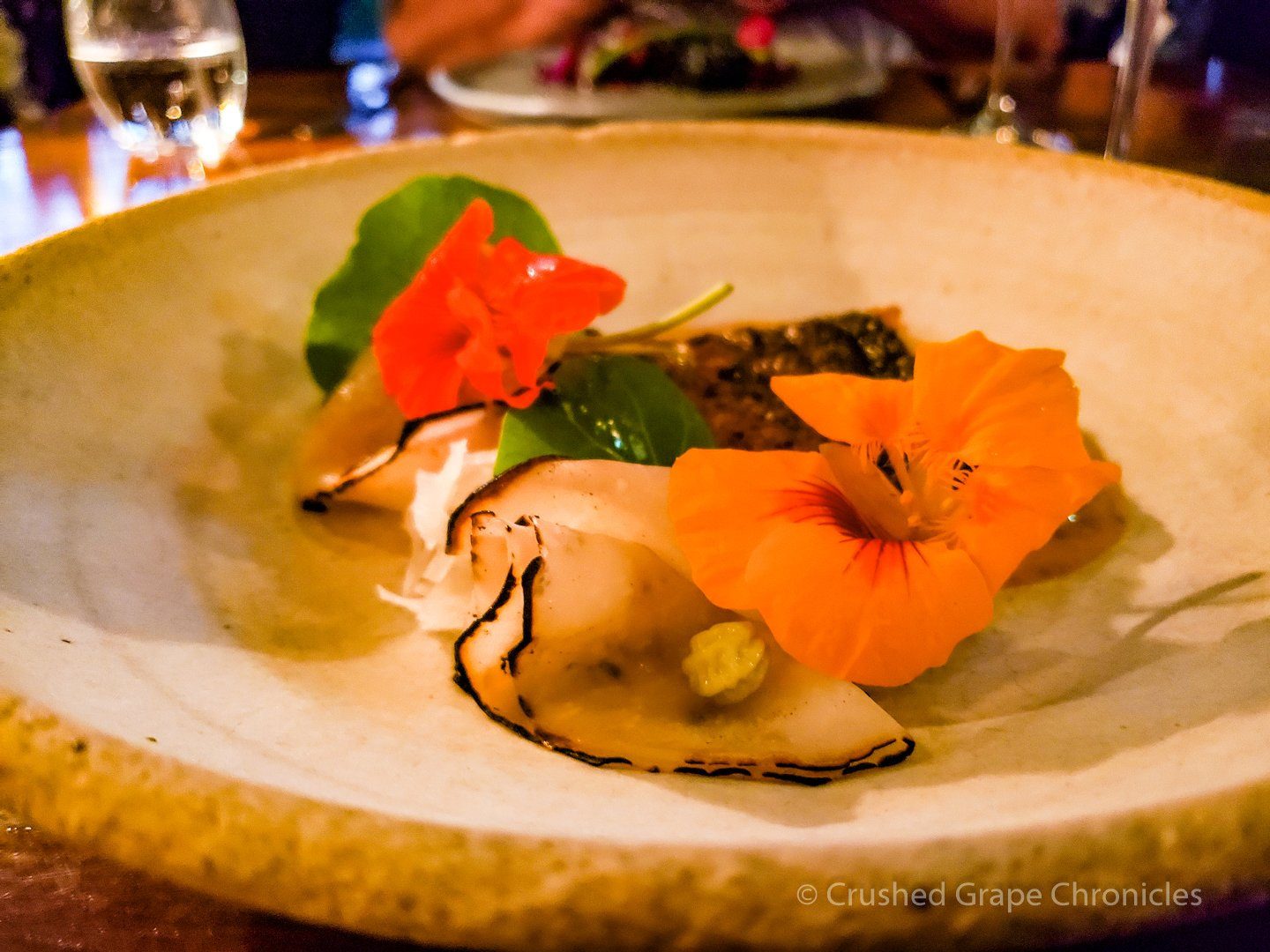 Dinner at Muse 3rd Course Barbequed Murray Gold cod, kohlrabi, XO butter, nasturtium seeds, leaves and flowers Hunter Valley NSW Australia