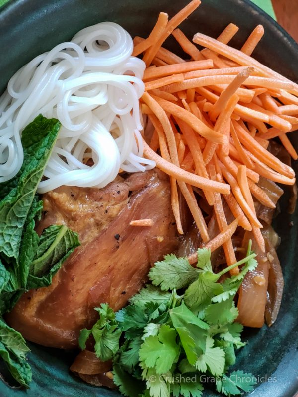 Chicken Adobo with vermicelli rice noodles, mint, cilantro and carrots