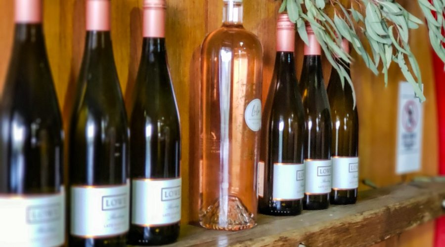 Bottles of the Lowe Wine Nullo Mountain Riesling lined up on a foudre in the tasting room Mudgee NSW Australia