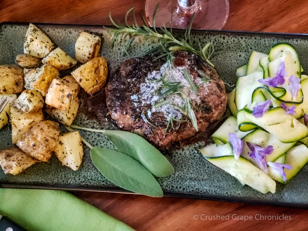 Herb encrusted steak, roasted potatoes and zucchini ribbon salad with Malbec Espuela Del Gaucho