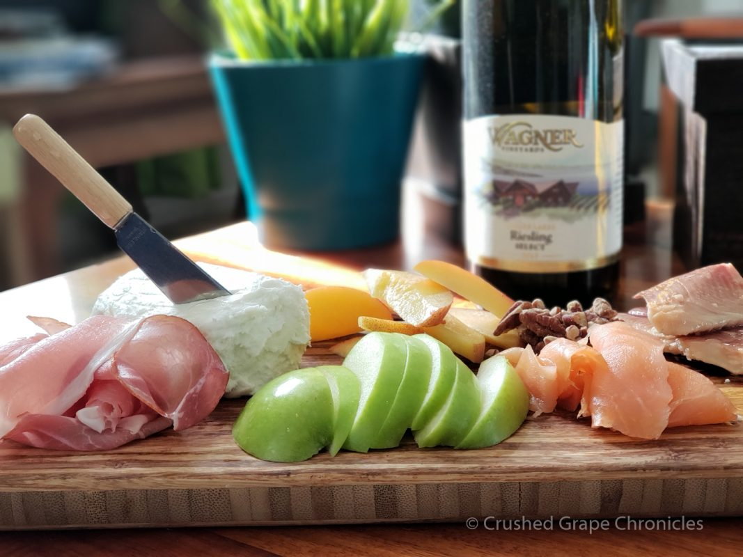 Goat cheese, apple, salmon, peach, proscuitto with Finger Lakes Riesling