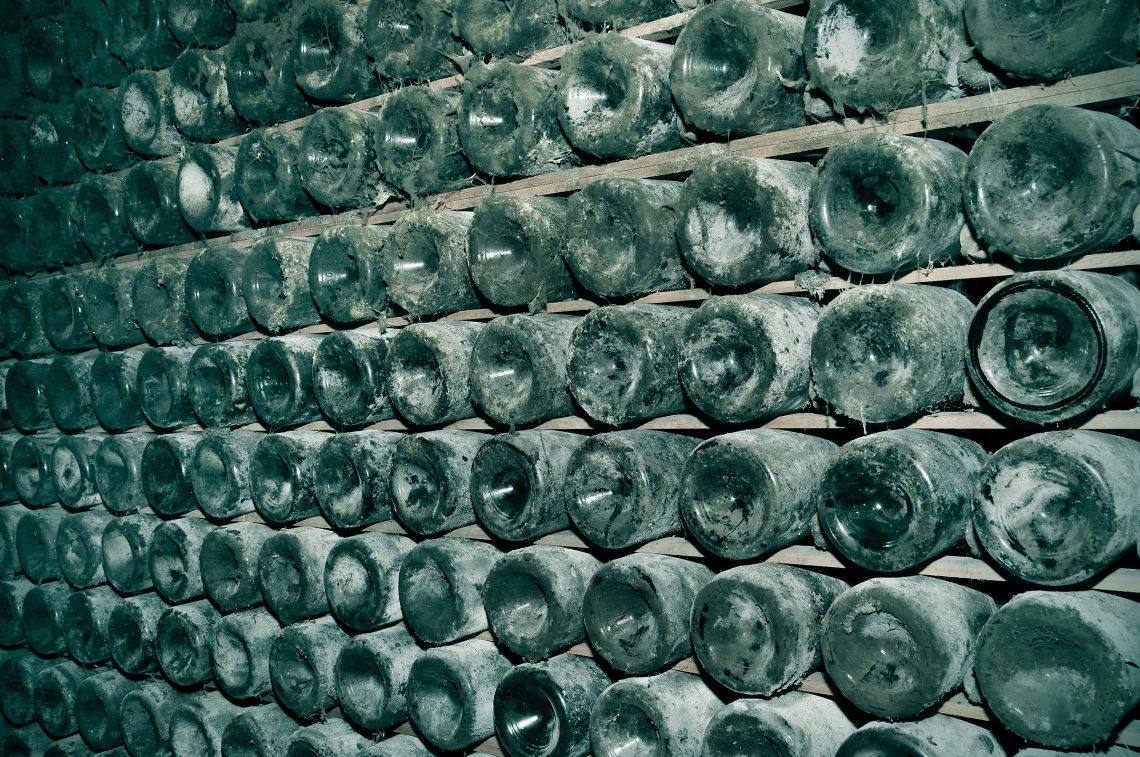 Spanish Cava bottles in a wine cellar, nito, Adobe Stock