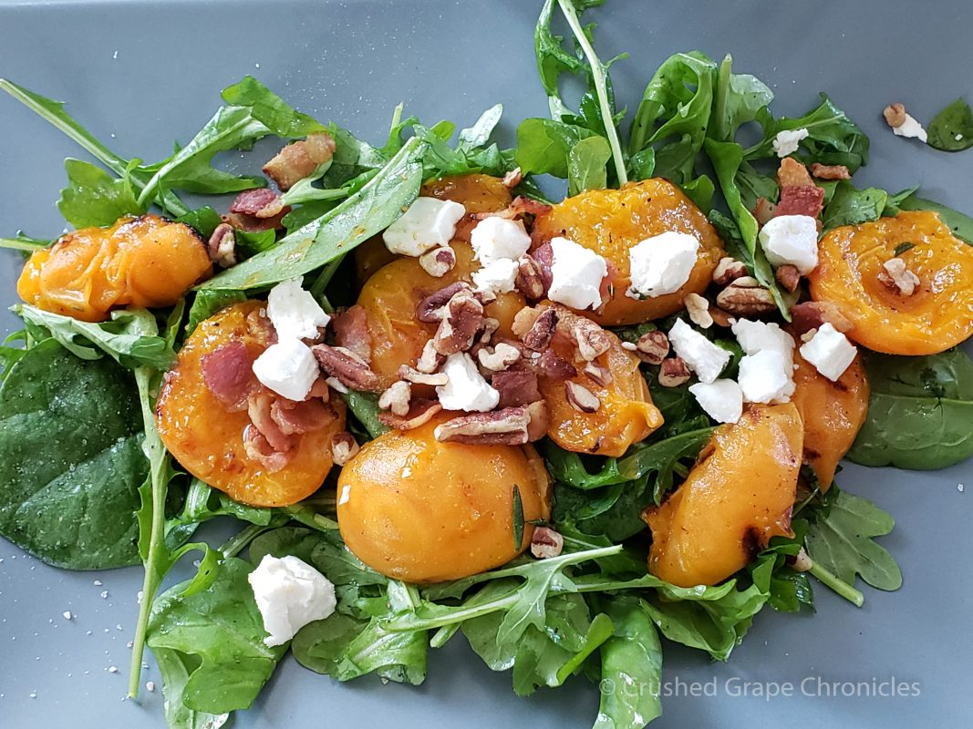 Roasted apricot from Gilcrease Farm with bacon, goat cheese and pecans on greens.