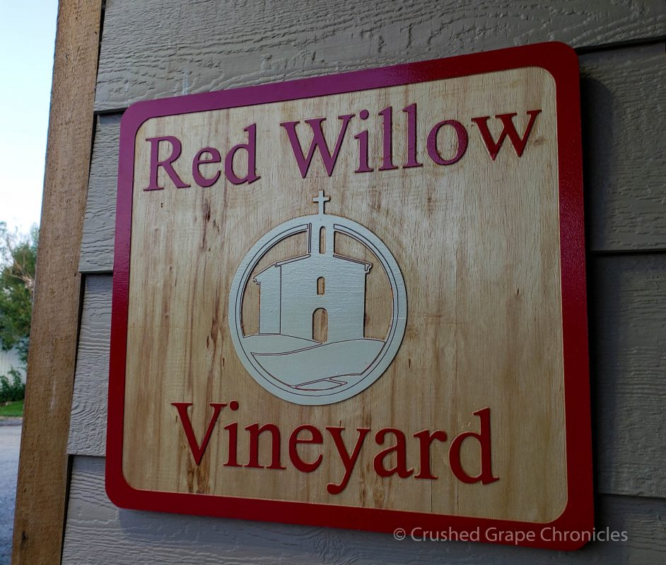 The sign for Red Willow Vineyard with it's iconic chapel