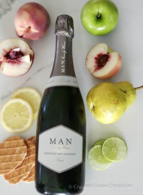 Man Cap Classique with aroma profile of white peach, granny smith apple, pear, lemon, lime, and biscuit cookies.