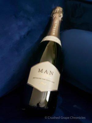 Bottle Man Family Wines Methode Cap Classique Brut bottle on a blue velvet background