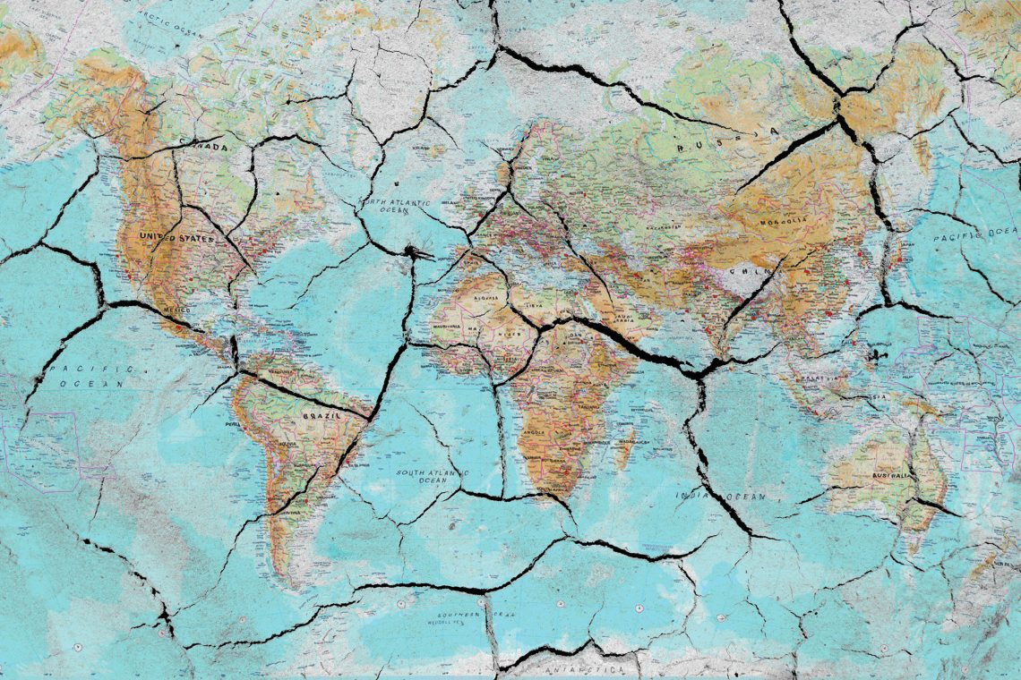 World map with dried cracking due to climate change
