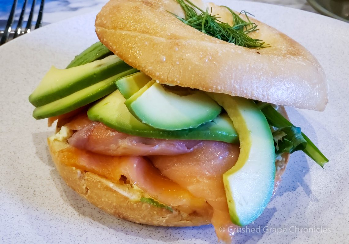 Bagel with cream cheese, lox, avocado, fresh greens and dill for breakfast at the Byng Street Boutique Hotel in Orange, NSW Australia