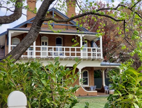 Byng Street Boutique Hotel through the trees from Byng Street showing the beautiful Original Heritage Wing in Orange, NSW Australia