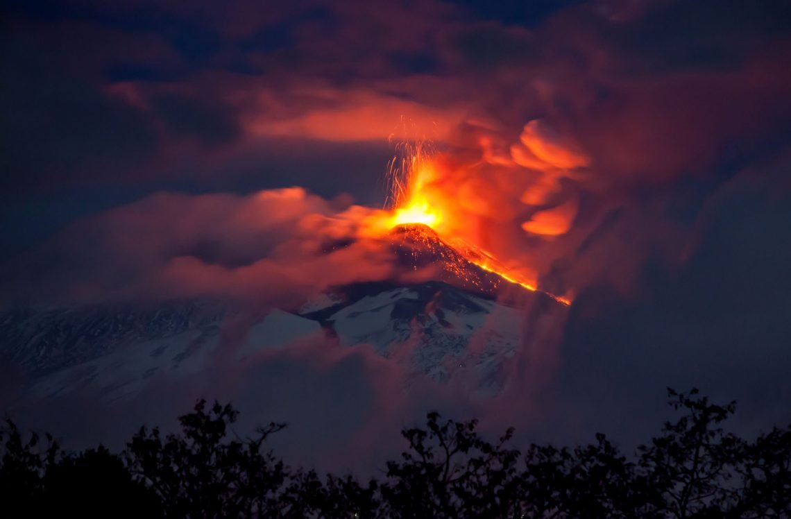 Erupting Volcano at Night with Lava - Mount Etna in Sicily, Italy photo by Moments by DeWi Adobe stock