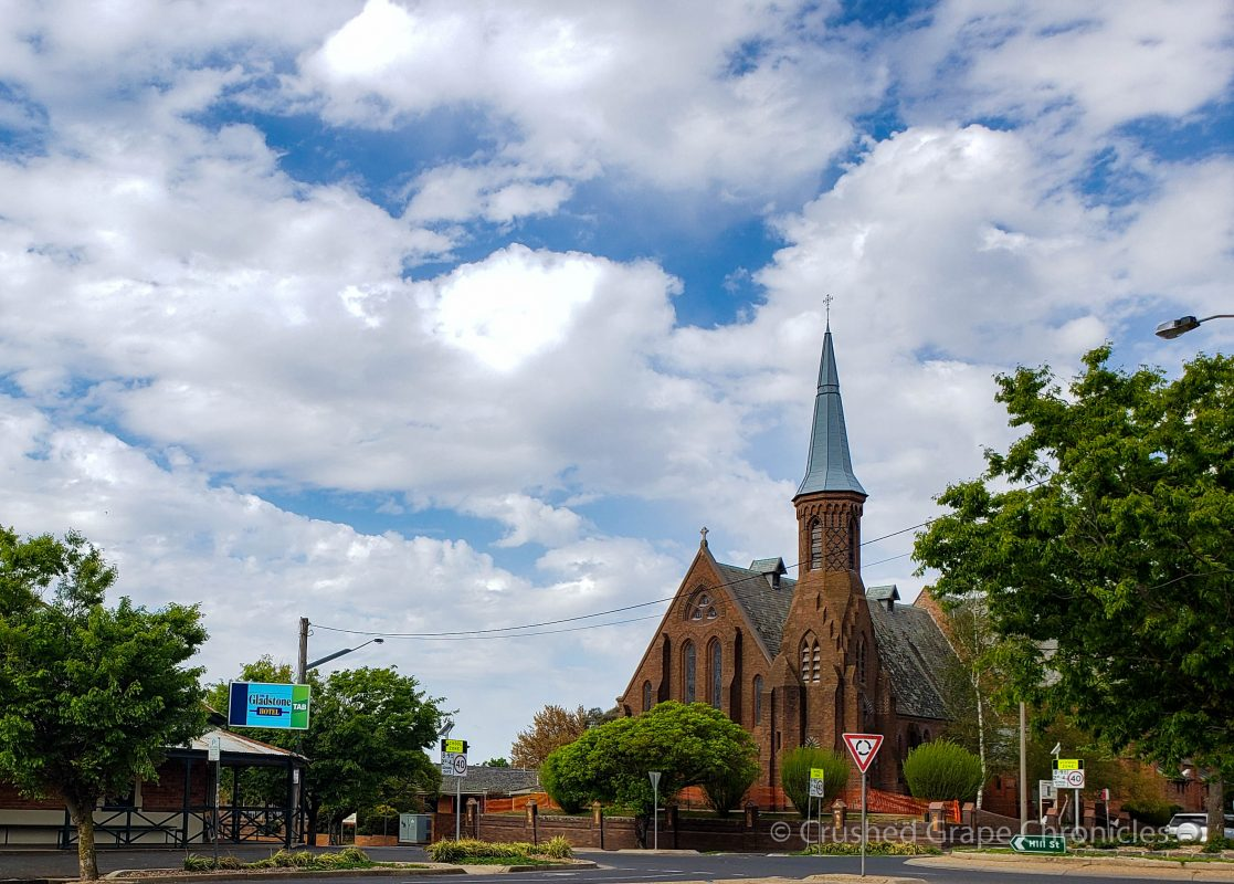 The Gladstone Hotel and a historic church across from the Byng Street Boutique Hotel Orange, NSW Australia