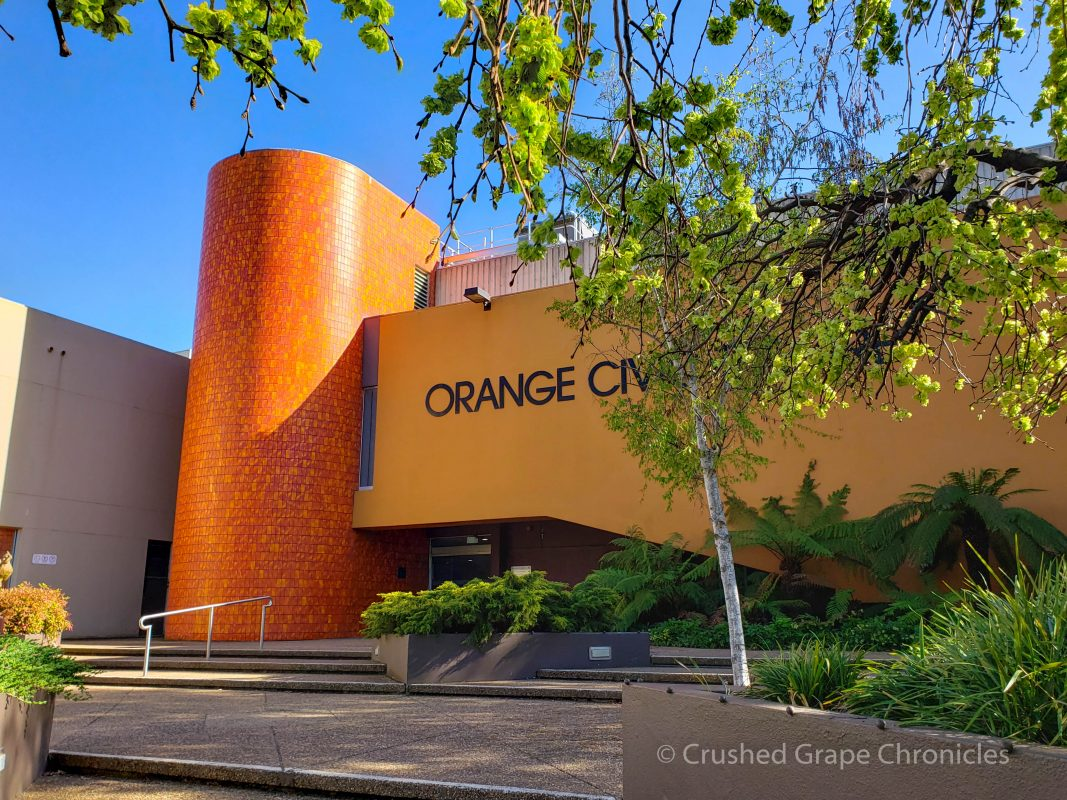 The Orange Civic Theatre surrounded by trees in their bright green spring finery in Orange, NSW Australia