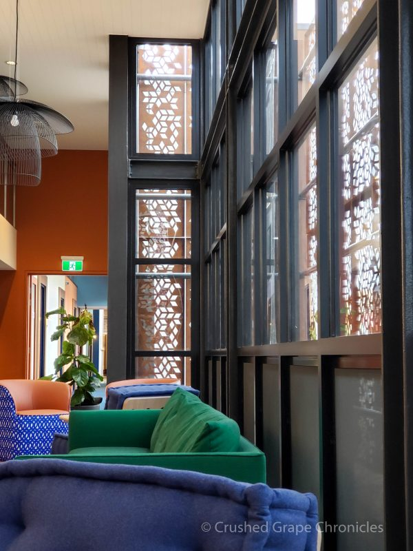 The guest lounge with its architectural screen keeping the light soft and cozy. Byng Street Boutique Hotel, Orange, NSW Australia