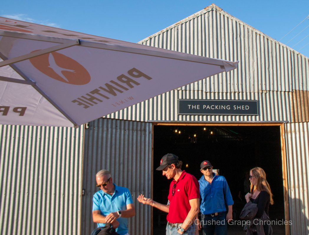 Ed Swift and Drew Tuckwell with guests in front of the Printhie Packing Shed Cellar Door in Orange NSW Australia