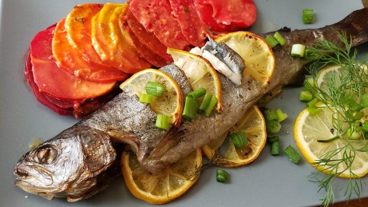 Baked Rainbow trout and a rainbow of root vegetables in a gratin scaled