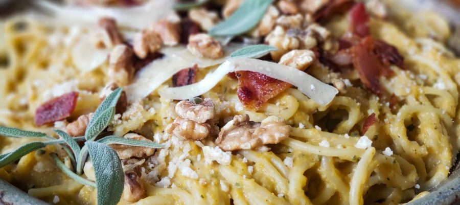 Bacon butternut pasta topped with sage, toasted walnuts, and parmesan