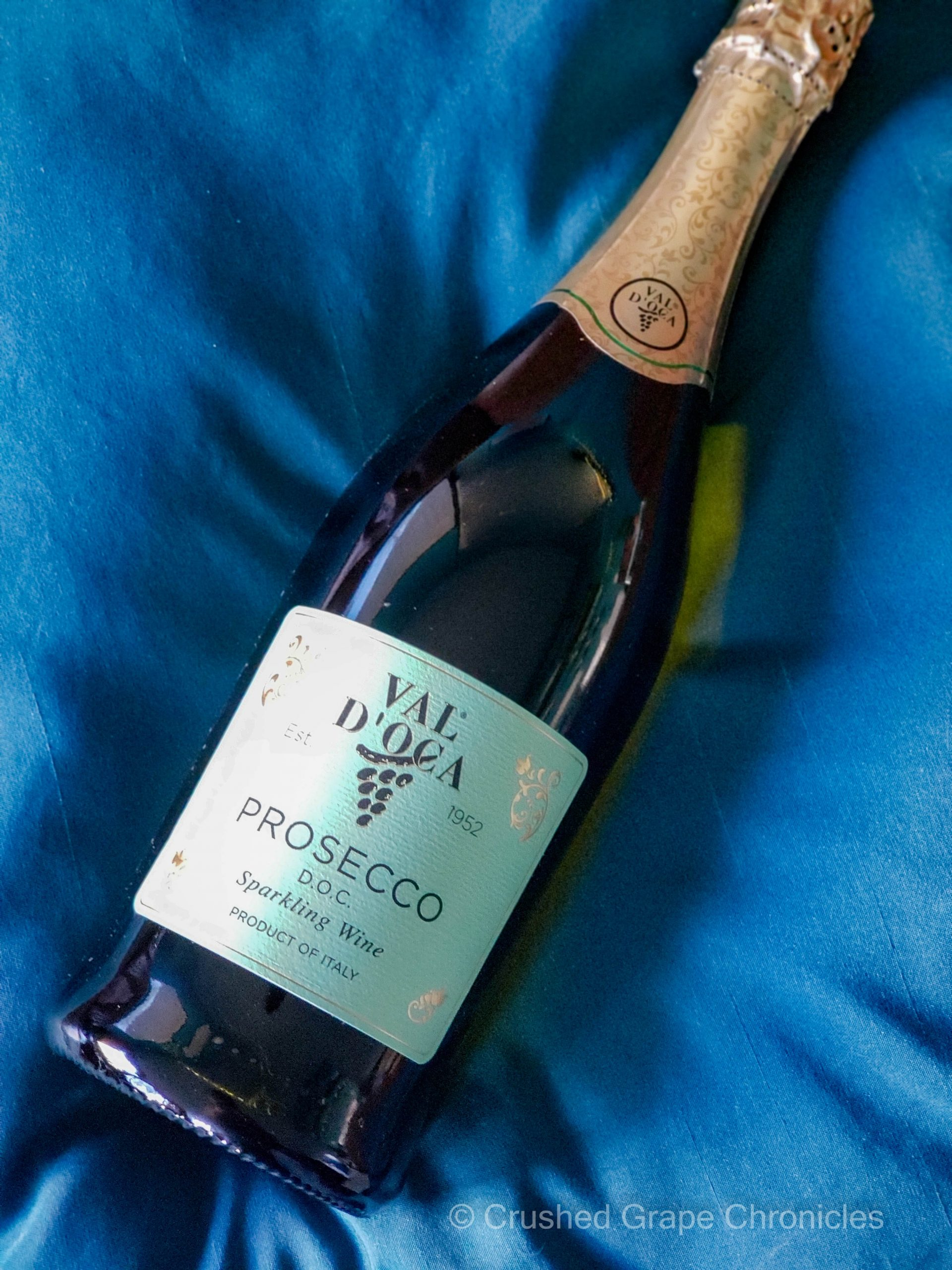 Val d'Oca Prosecco bottle shot on pillow