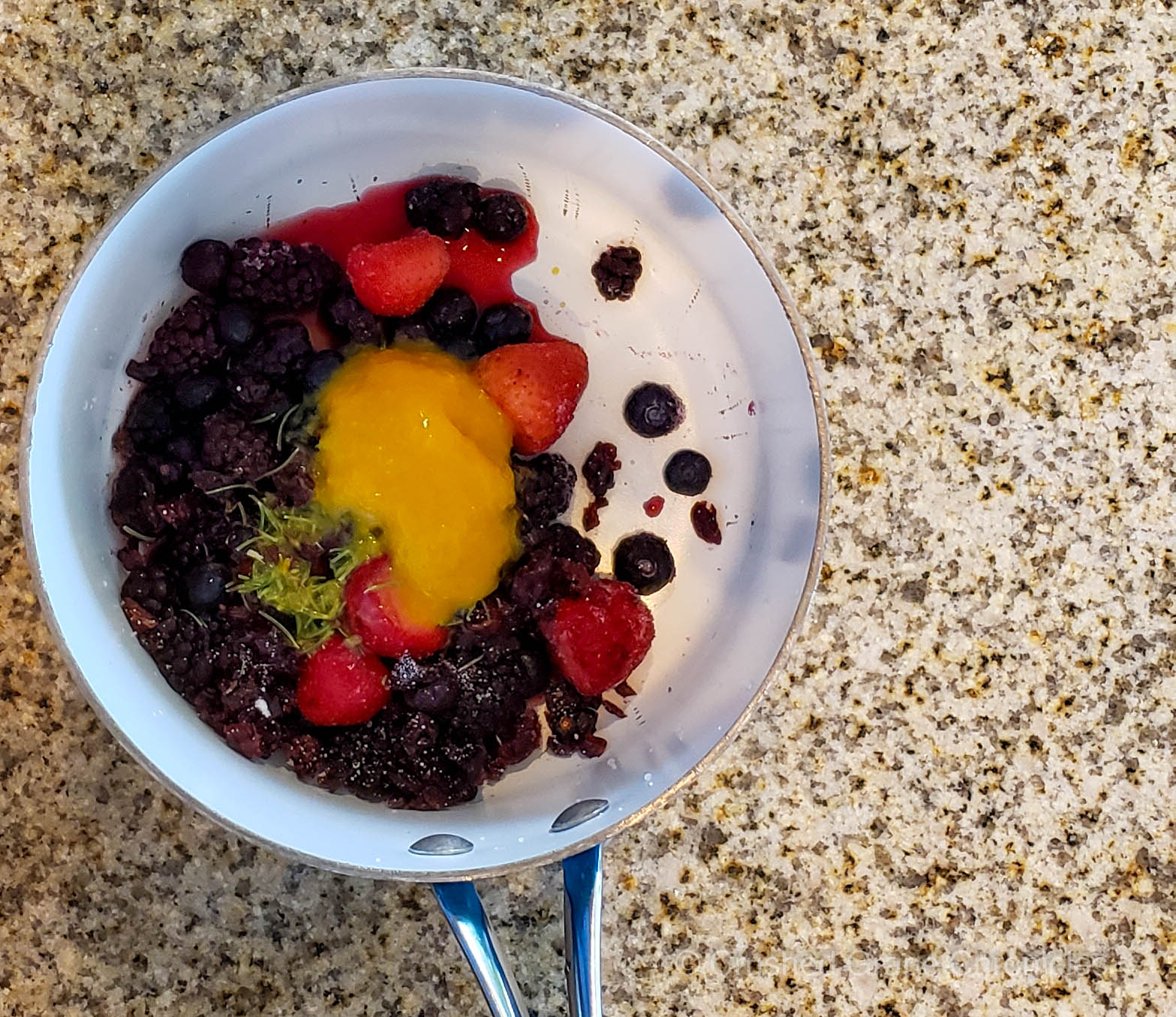 Savory berry drizzle ingredients in a pot