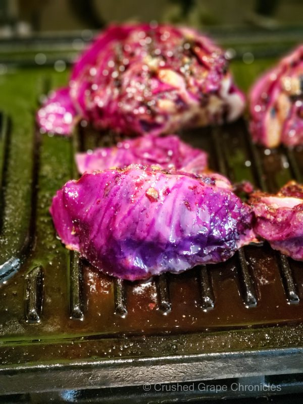 Marinated purple cabbage wedges on the grill