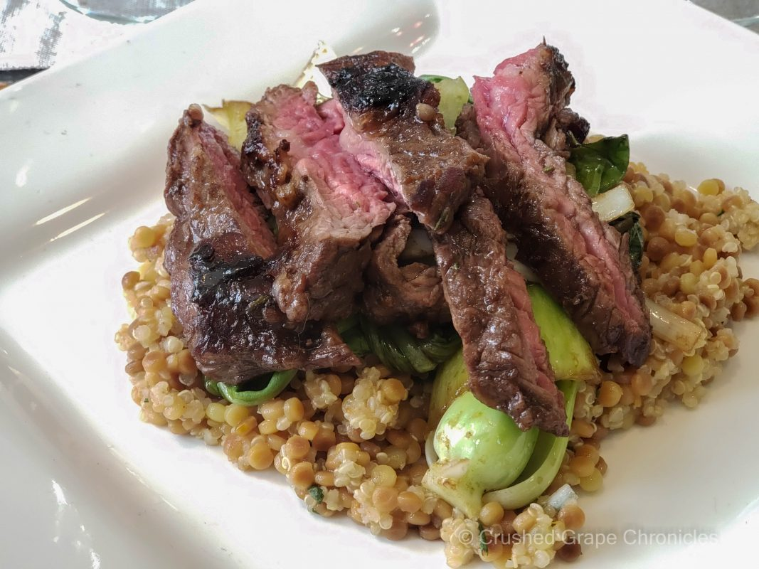 Seared balsamic skirt steak with bok choy, leeks and a cous cous blend