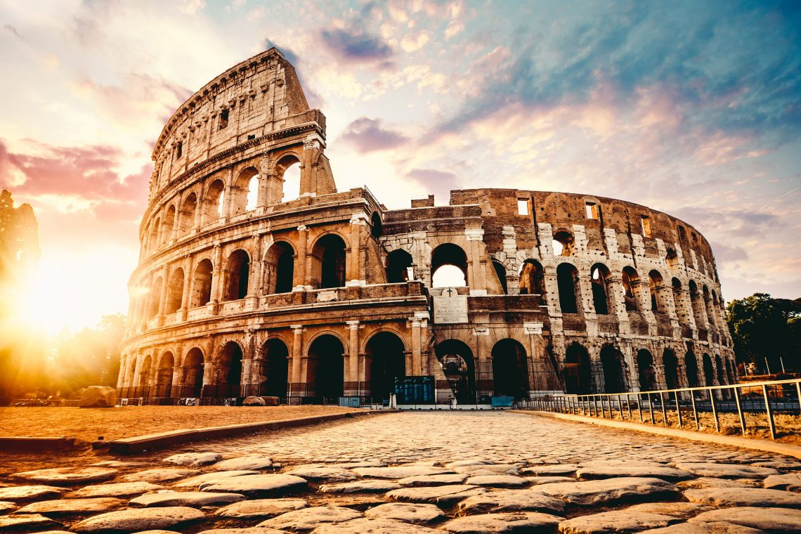 The ancient Colosseum in Rome at sunset (Adobe Stock photo by kbarzycki)