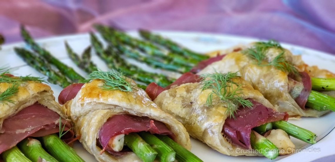 Asparagus wrapped in pastry with prosciutto and herbed goat cheese