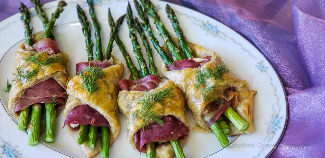 Pastry wrapped asparagus with proscuitto and herbed goat cheese