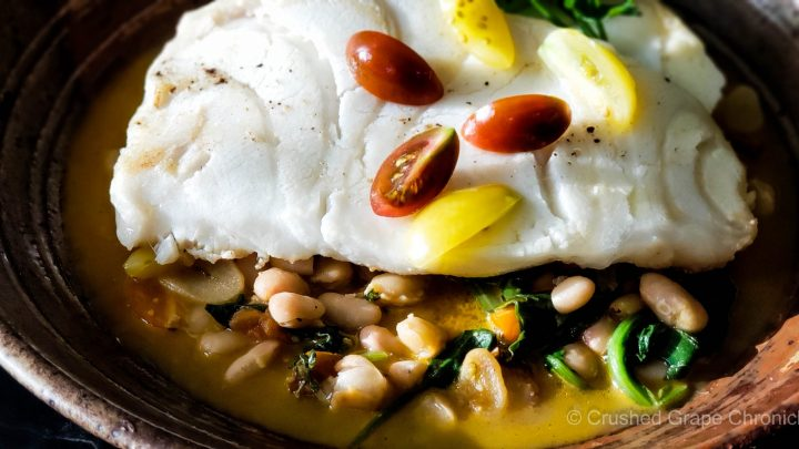 Sea bass on white beans, cherry tomatoes and spinach