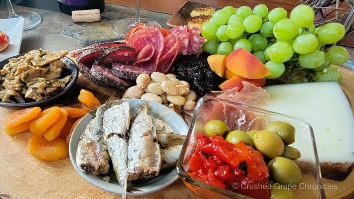 Sardines and tuna in oil, cured meats, almonds, olives and peppers, peaches, sundried tomatoes, hard goat cheese, and dried apricots to pair with the wines from Maury