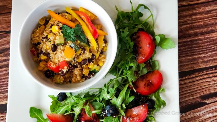 Quinoa with black beans and vegetables and an arugula blueberry, red plum salad